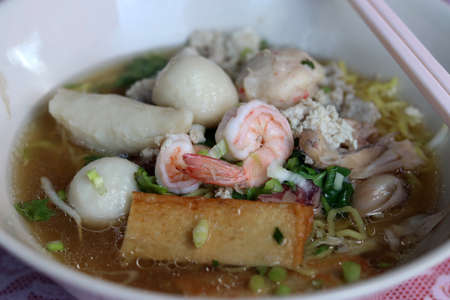 Spicy seafood noodles soup in Thai style.