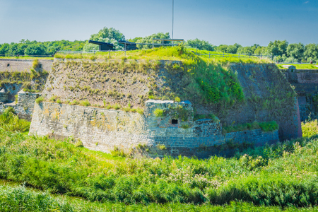 massive old wall with cannons in a beautiful landscape Banque d'images - 106457251