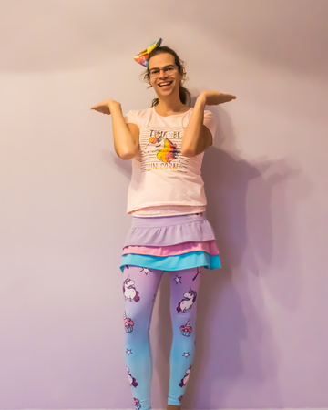LGBT funny gender bending in unicorn kawaii outfit making i don't know pose Foto de archivo