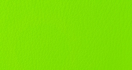 Modern green fake leather skin pattern texture background in macro close up