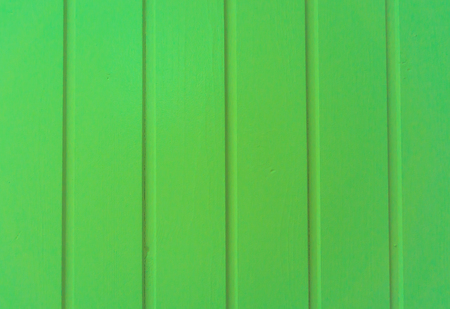 green painted vertical wooden planks background structure