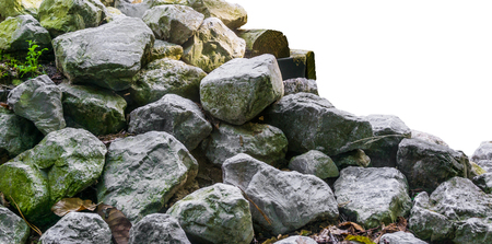 Pile of lime stone rocks in close up isolated on a white background nice garden decoration