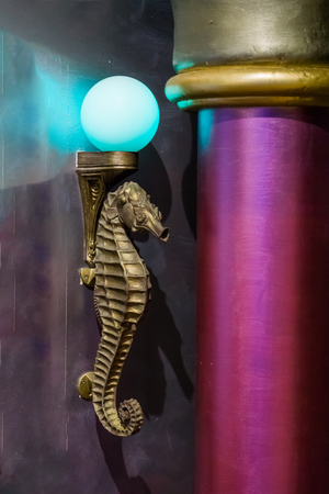 golden antique seahorse marine life animal sculpture lamp with a blue light bulb Foto de archivo - 112920978