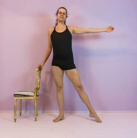 Young transgender girl practicing ballet, ronde jambe a classical dance move, LGBT in the dancing sport
