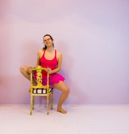 Young transgender ballet dancing girl posing on a chair, LGBT portrait in the sport
