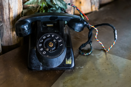 old black vintage telephone on a table, Retro telecommunication in the old days