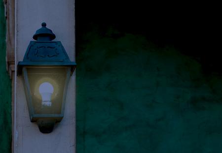 vintage lantern shining bright light in the dark, home decorations and lighting Foto de archivo