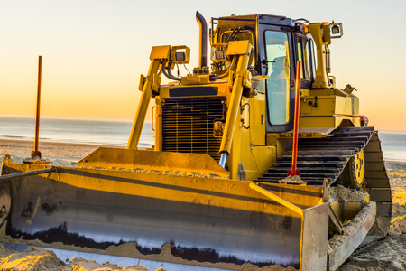 bulldozer with a scoop, ground mover machine, groundwork industry equipment 스톡 콘텐츠