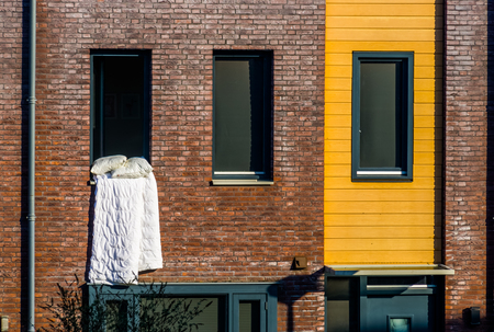 White Blanket hanging outside of the window, Ventilating the bed linen, typical dutch Architecture