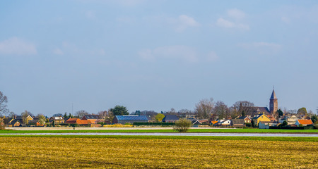 skyline of the village of Rucphen, a small rural village in North Brabant, The Netherlands, view from the pasture