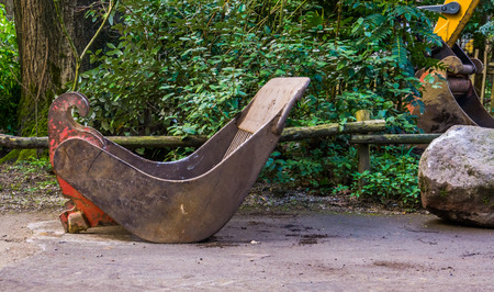 old weathered digging scoop in closeup, equipment for the excavator, earthmoving industry background Reklamní fotografie