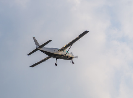 recreational airplane flying with cloudy weather, air transportation, hobby and sports Stock Photo
