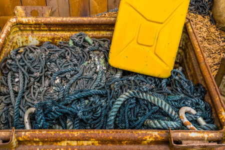 box full of ropes and a jerry can, sailing equipment, nautical background
