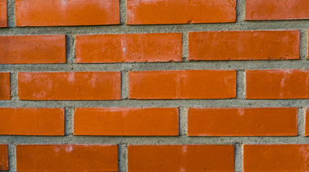pattern of a Modern wall made of cement and orange bricks, Construction industry background