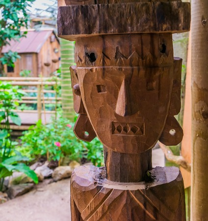 carved wooden statue of a native person, african garden decorations