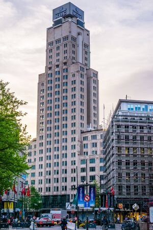 Antwerpen, Belgium, April 23, 2019, The KBC bank building in antwerp city with street view, large sky scraper in a popular belgian city