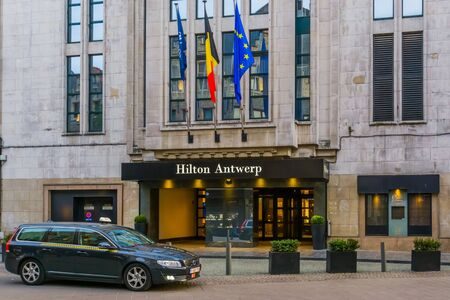 Antwerpen, Belgium, April 23, 2019, The entrance of the Hilton Hotel in Antwerp city with a taxi car waiting in front of the door Editorial
