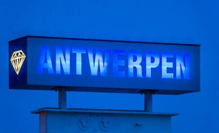 blue neon light board with the text antwerpen, Sign post by night in antwerp, Belgium Banco de Imagens