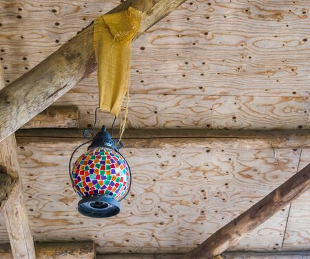 Vintage lantern with multicolored glass, beautiful retro decoration, ornamental lights Foto de archivo