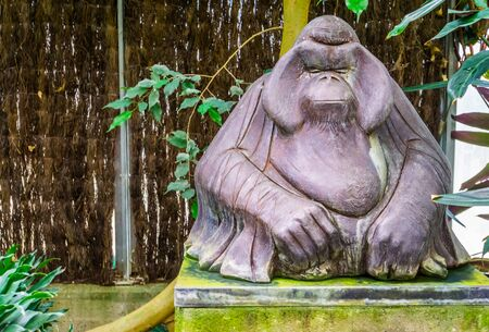 marble animal statue of a orangutan, Big ape sculpture, tropical garden decoration Фото со стока
