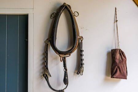 Old vintage horse drafting collar, nostalgic farm equipment for plowing Фото со стока