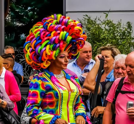 closeup portrait of a funny drag queen wearing a rainbow wig and a colorful dress, LGBT pride parade antwerp, Gender diversity, 10 august, 2019, Antwerpen, Belgium