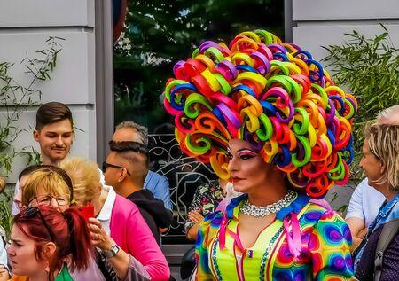 closeup of a beautiful drag queen in a colorful dress and rainbow wig, Gender diversity, LGBT pride parade antwerp, 10 august, 2019, Antwerpen, Belgium