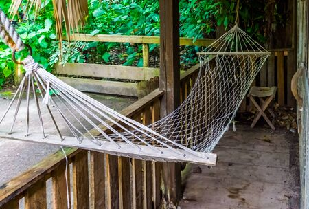 closeup of a hammock on a balcony, travel and relaxation background, Garden furniture