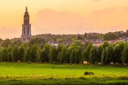 View on the city of Rhenen with church tower during sunset, Beautiful Rustic town in the netherlands