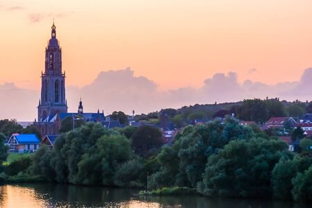 Rhenen city with church tower during sunset, Rustic town with water, The netherlands