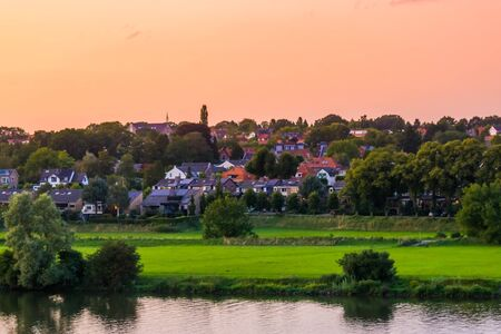 Rhenen a rustic town in the Netherlands, cityscape at the water during sunset