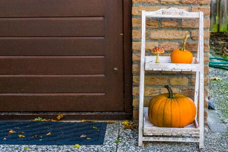 Autumn and halloween decorations at the door, Traditional home ornaments, Seasonal background