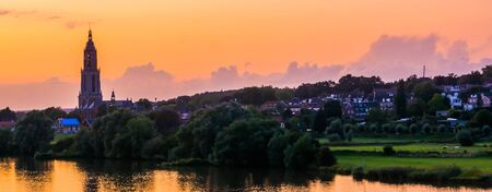 beautiful city skyline of Rhenen during sunset, beautiful rustic town with water, The netherlands
