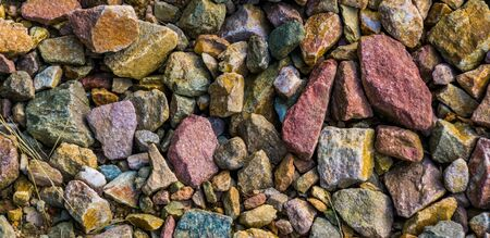 gravel stones in diverse colors in closeup, stone pattern background Stockfoto