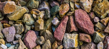 macro closeup of gravel stones in diverse colors, rock pattern background Stockfoto