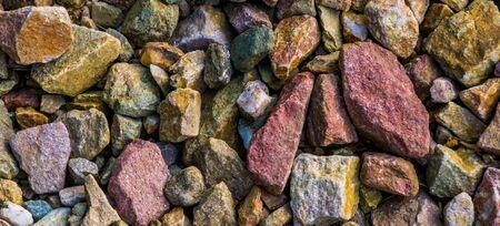 macro closeup of gravel stones in diverse colors, rock pattern background Imagens