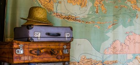 travel background, Suitcases with hat and a map, Adventurous journey, Traveling business