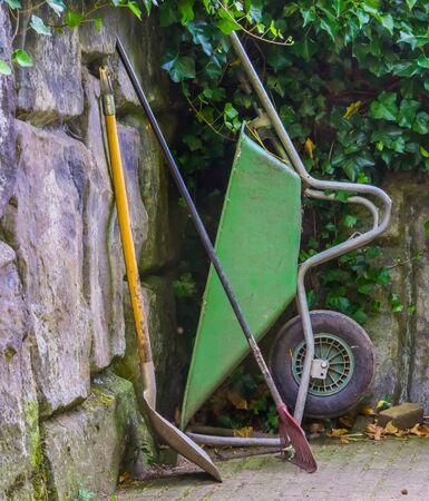 Basic gardening equipment, a wheelbarrow with a shovel and rigid, Garden upkeep tools