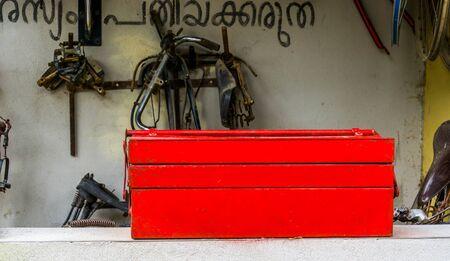 red toolbox with bicycle repair equipment, Vintage bike repair background