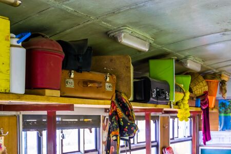 wooden board filled with passengers baggage in a nostalgic train wagon, Vintage travel background Archivio Fotografico
