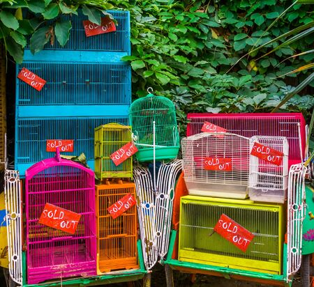 Many bird cages that sold out all the birds, pet trade in Asia, animal exploitation background