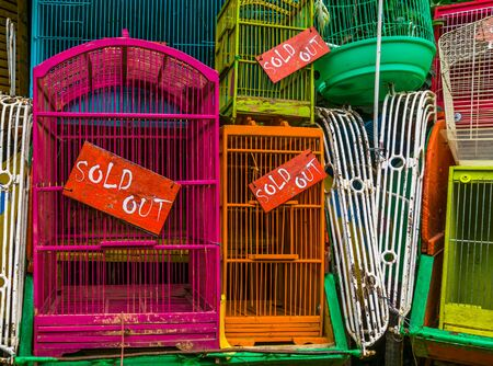 bird cages with sold out signs in closeup, Pet trade in Asia, Animal business background