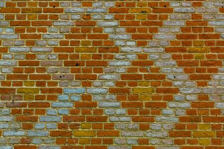 Brick wall with a modern diamond pattern in diverse colors, New trendy architecture background Stockfoto
