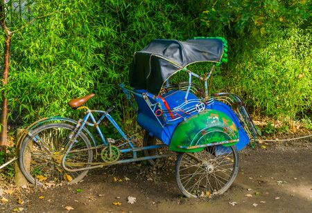 Side view of a traditional Asian cycle rickshaw, Vintage transportation vehicle from Asia