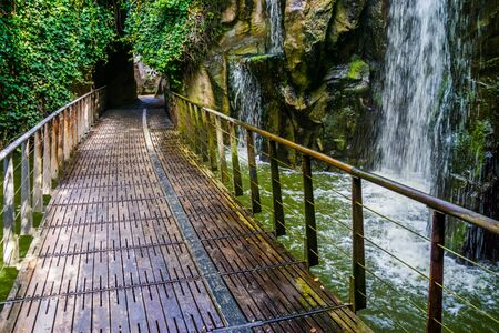 Walking path with a waterfall, beautiful nature and garden architecture Stockfoto