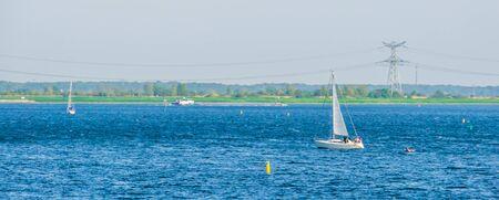 Boat sailing in the ocean of the Oosterschelde in Tholen city, Bergse diepsluis, Zeeland, The netherlands
