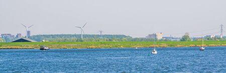 ocean scenery with boats sailing on the water in Tholen city, Oosterschelde, Bergse diepsluis, Zeeland, The netherlands