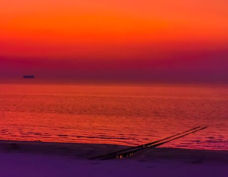 The beach of domburg with ocean during a very colorful sunset, Zeeland, The netherlands