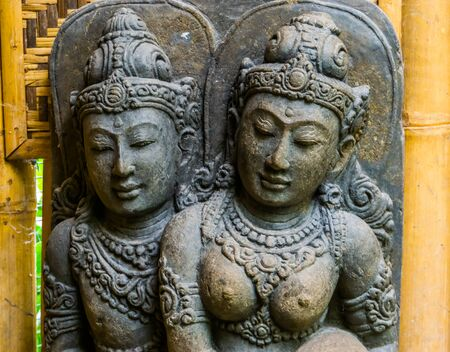 sculpture of a spiritual male and female together, traditional art work and decoration