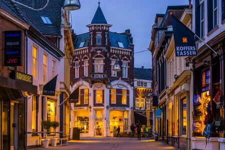 Lighted city street in tilburg outdoor shopping center, illuminated architecture in the evening, Tilburg, The Netherlands, 10 December, 2019
